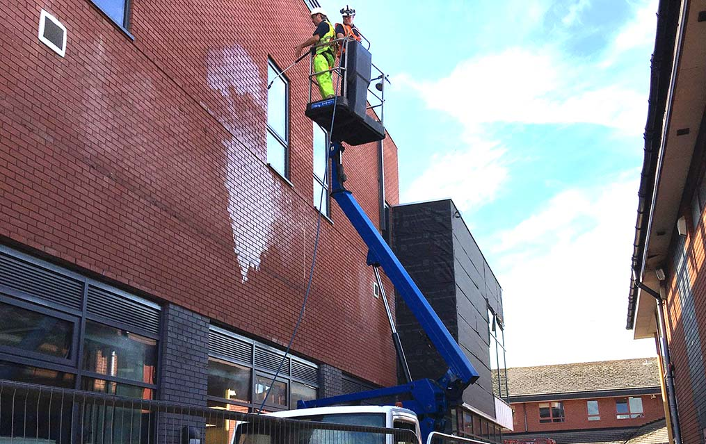 Cladding and building cleaning with cherry picker hire services UK
