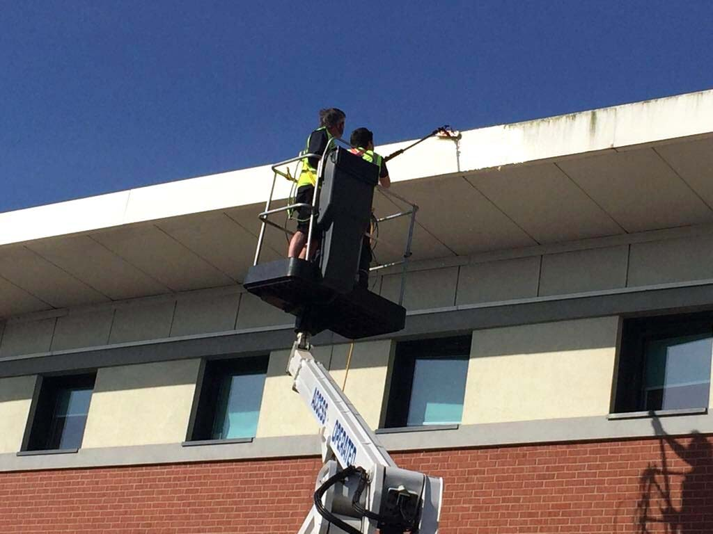 Cleaning cladding and fascias with cherry picker hire services